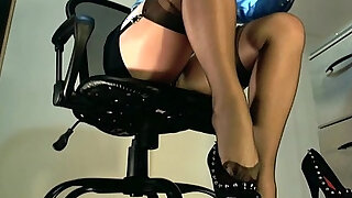 sexy video: Underdesk tease showing stockings over nylons